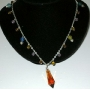 Fancy Beads accented in Silver chain with tear drop pendant